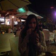 Snook's Bayside Restaurant - Marti drinking coconut and cranberry - Key Largo, FL, Vereinigte Staaten