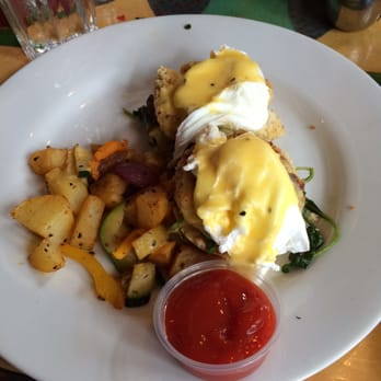Carroll Street Café - Atlanta, GA, United States. Crab cake Benedict with potatoes
