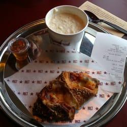 Porridge, honey and croissant--a…