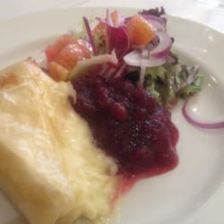 Baked Brie with cranberry relish and mixed green salad.