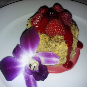 ... Crushed Hazelnuts, topped with Raspberries and a Raspberry Crème