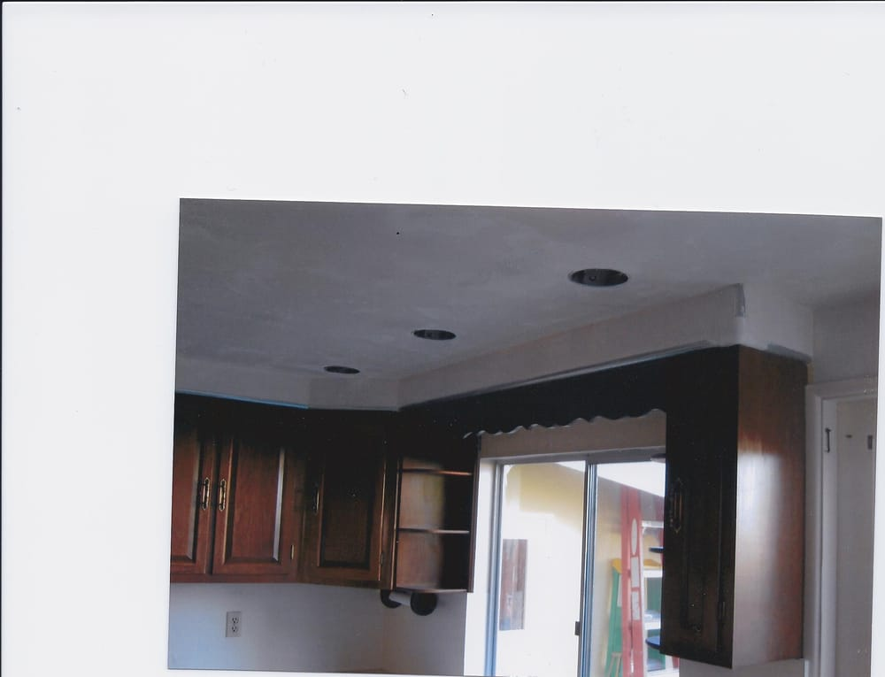 With drywall above cabinets and textured its ready for paint yelp