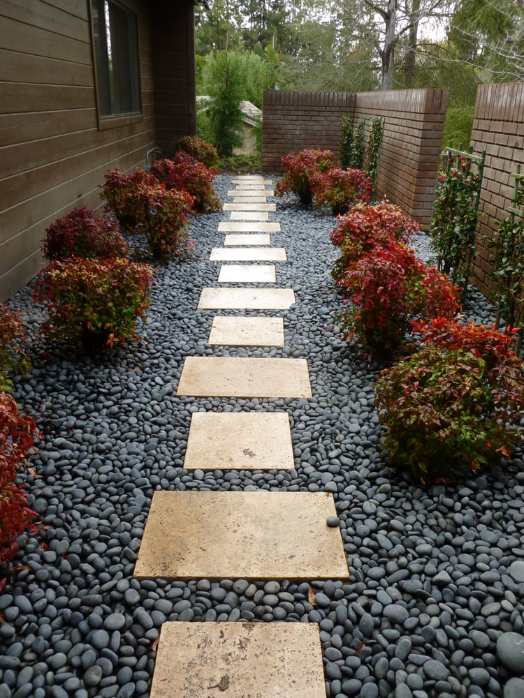 This small courtyard serves as access to the side yard for Small side garden designs