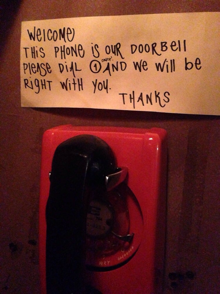 Instructions inside the phone booth | Yelp