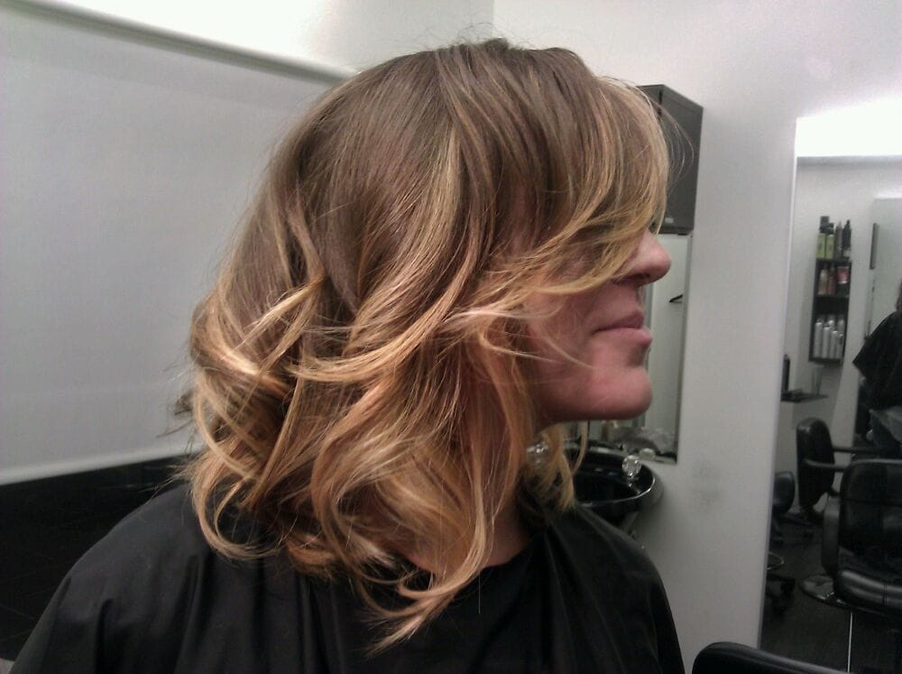 asymetrical hair cut with blush gold ombre on short hair