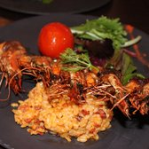 fried prawns with smoked fillet of duck and rice and spicy sausage