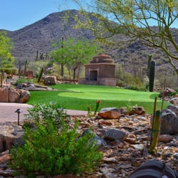 Desert landscape with artificial turf…