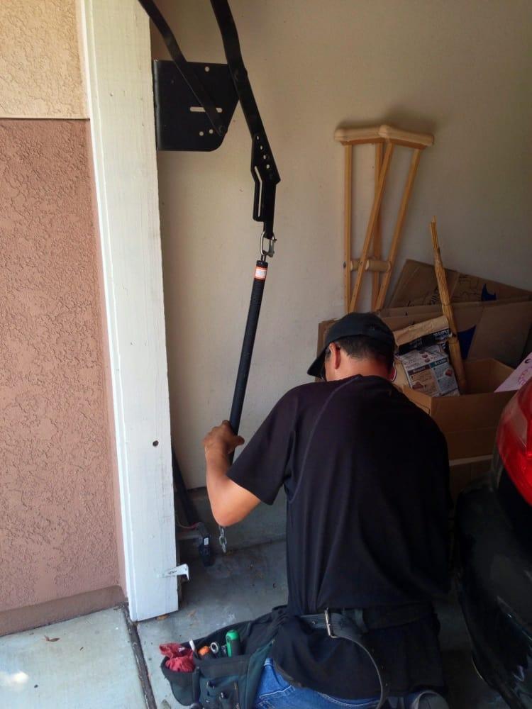 Always open garage doors 11 photos garage door for Garage door spring repair chula vista