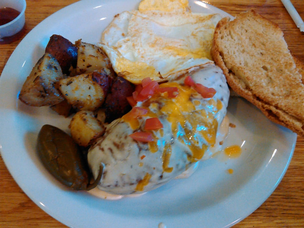 ... spicy cream sauce on top, two fried eggs and rosemary potatoes. | Yelp