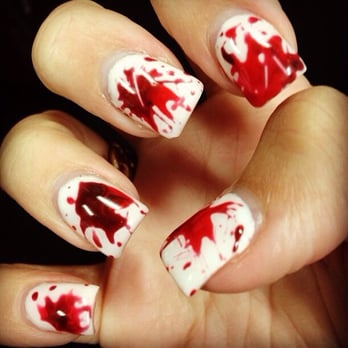 "Nails by Shyra. White sculpting gel with red gel ""blood spatter"""