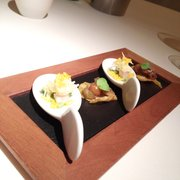 Greeting from the kitchen, curry chip with egg plant, spoon with smoked eel and pickles