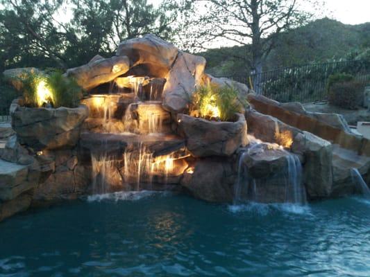 Rock waterfalls with slide added to swimming pool yelp Swimming pools with waterfalls and slides