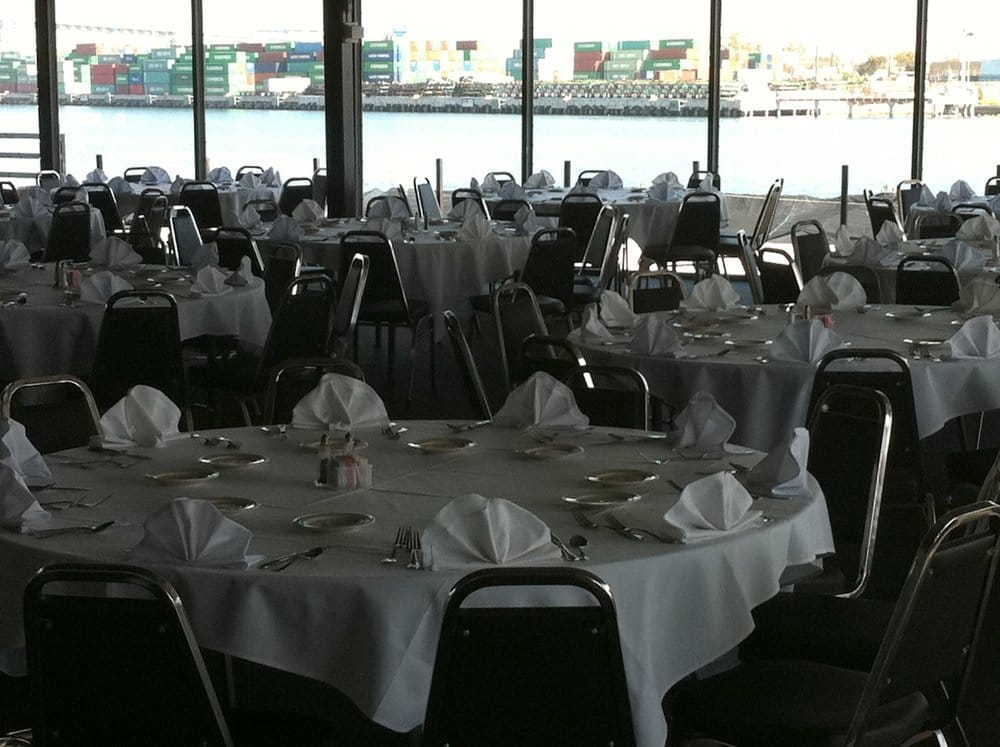Top of the market banquet room with white on white linen for San pedro fish market and restaurant