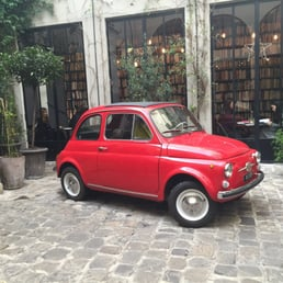 Little fiat at the entrance of the building