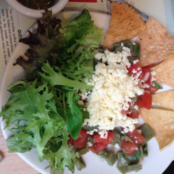 Ensalada de Nopalitos: cactus mixed with tomatoes, onions, coriander, lime and Ranchero cheese