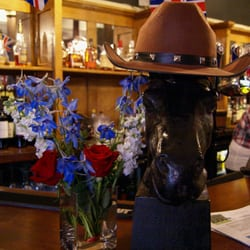 Leave your hat on the bar 'n grab a drink.