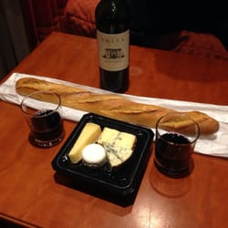 Assorted cheese, bread, and wine.