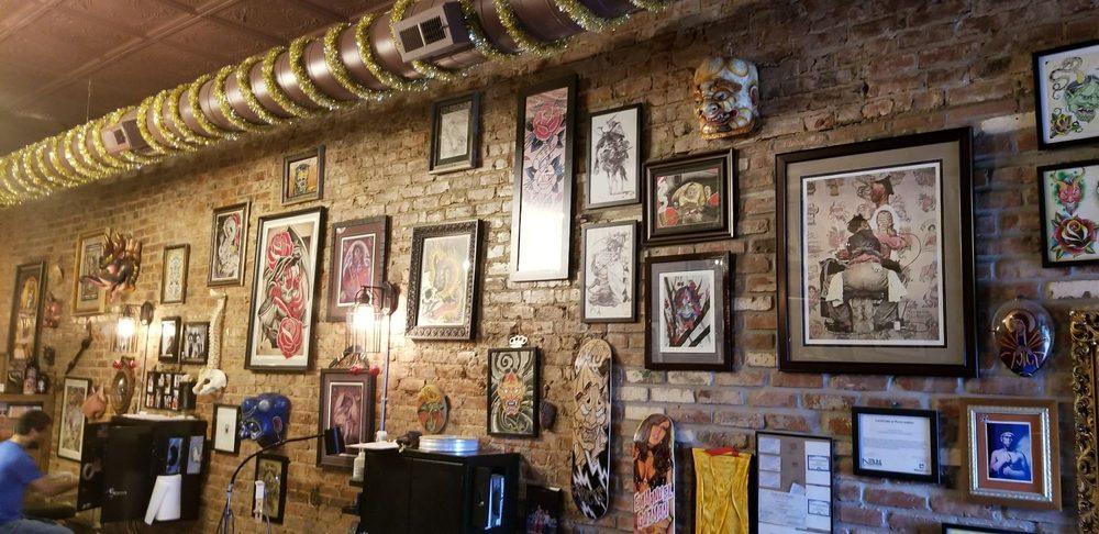 Tenth sanctum tattoo tatouage 1010 s 10th st little for Tenth street tattoo