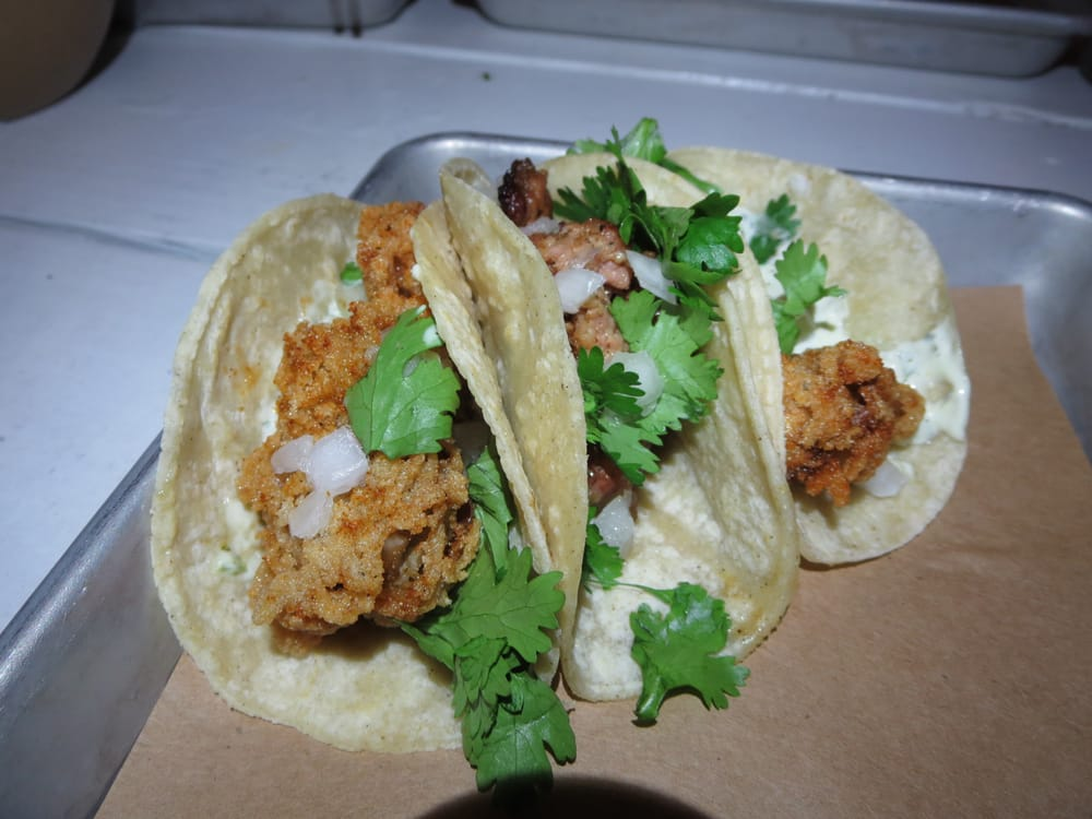 Two fried oyster tacos and one spicy chorizo taco. | Yelp