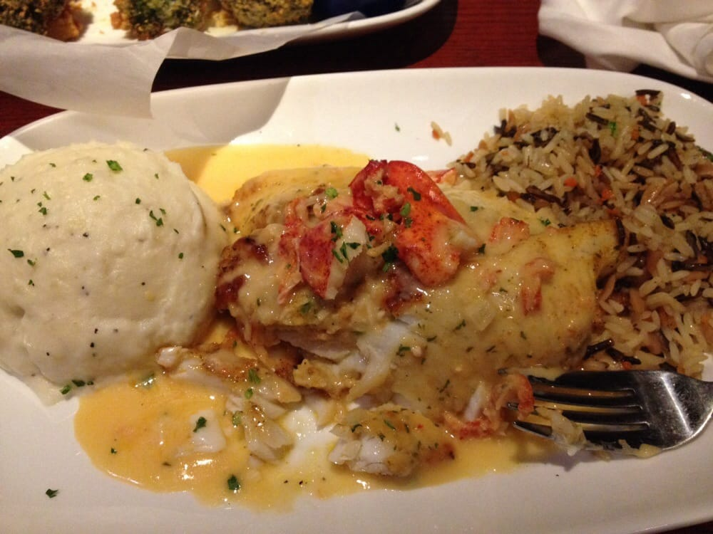 Crab and seafood stuffed tilapia with lobster cream for Stuffed fish with crab meat