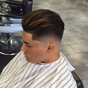 Undercut with a drop fade on the sides blow dried and styled