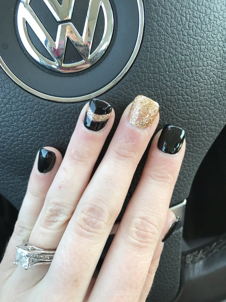 Full set of black nails with one gold nail and one black with gold ...