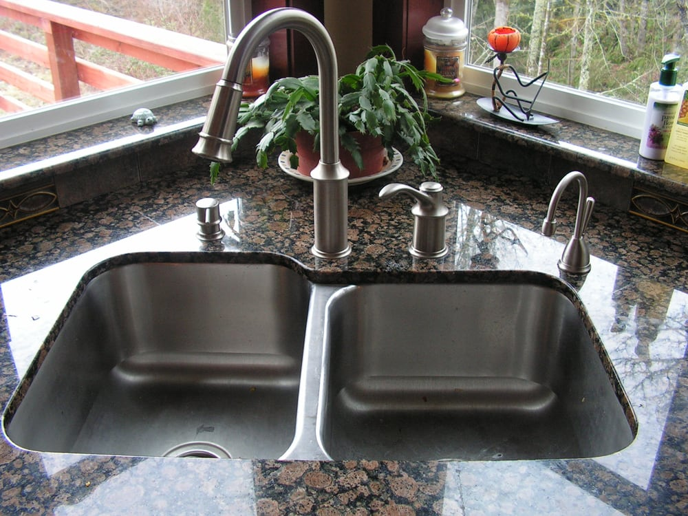 Moen Aberdeen kitchen faucet with soap dispenser to left and insta ...