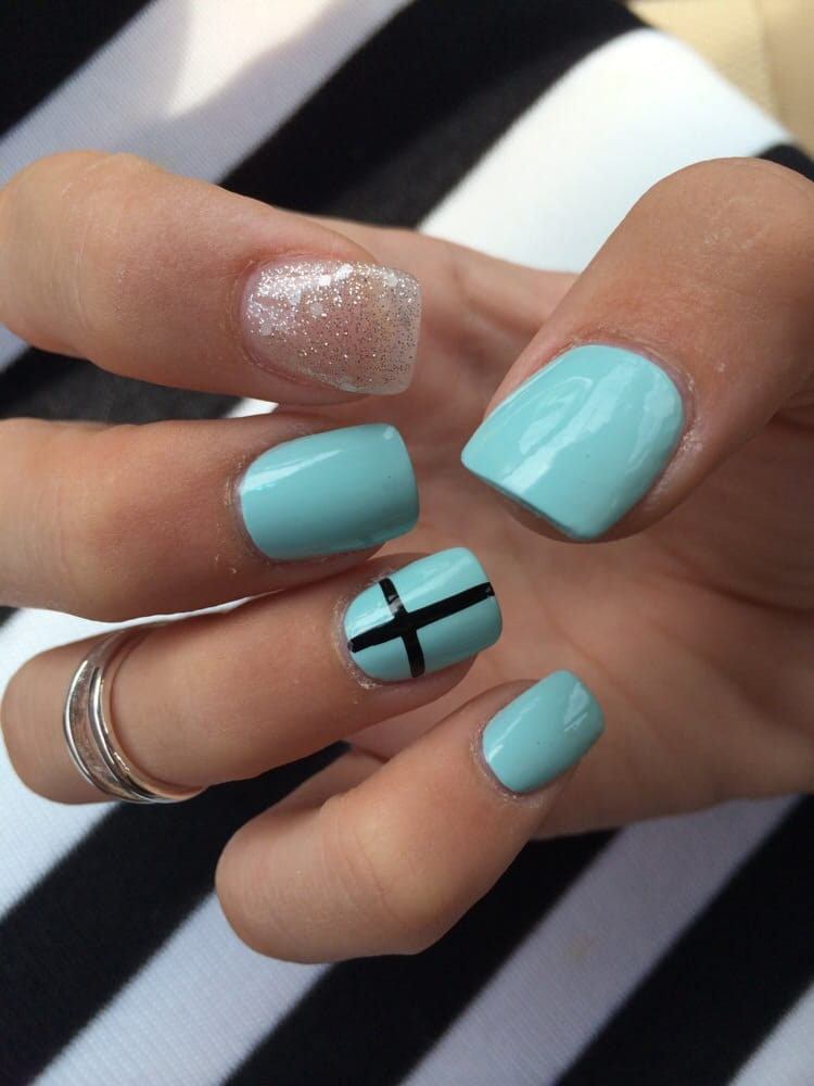 Clear nail with glitter, ESSIE mint candy apple polish, cross design ...