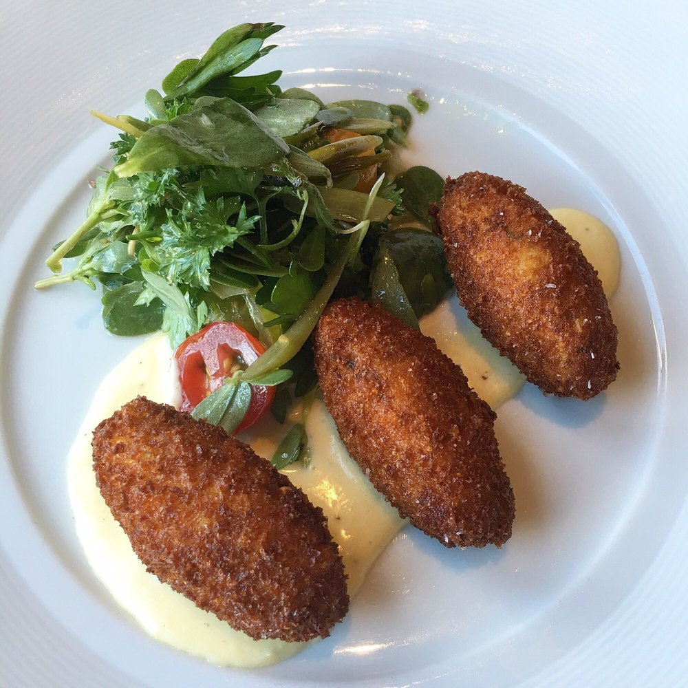 Brandade Fritters With Corn Pickled Scapes And Purslane