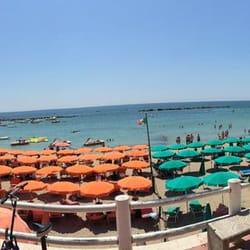 Photo Of Spiaggia Santa Marinella Roma Italy Beach Umbrellas