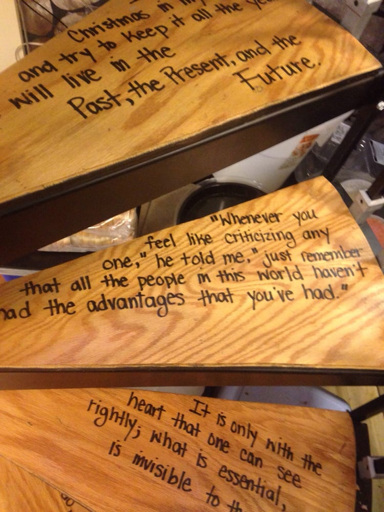 The Spiral Staircase Leading Upstairs Has Quotes From Different