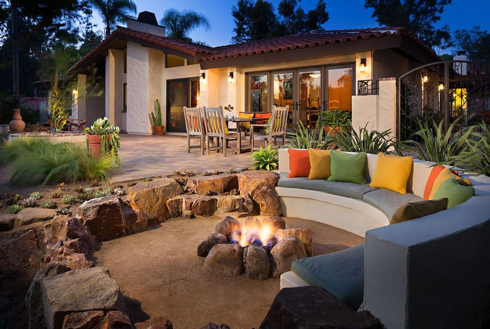 Sunken Patio With Decomposed Granite And Boulders Creating