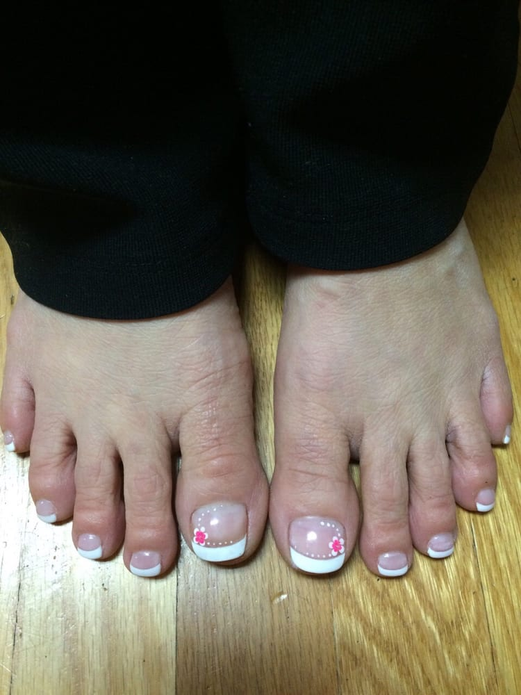 Gel french pedicure with a simple flower design done by Tina. - Yelp