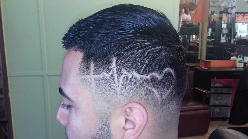 Skin low fade with a little freestyle design yelp for Renee hair salon
