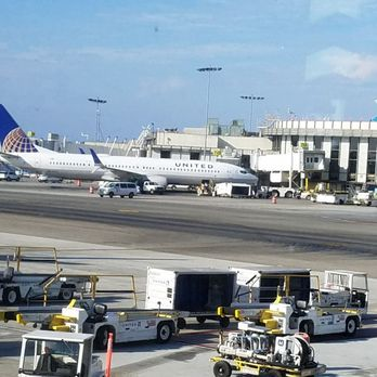 'Photo of Los Angeles International Airport - LAX - Los Angeles, CA, United States. Looking out the window of the United Airlines terminal.' from the web at 'https://s3-media2.fl.yelpcdn.com/bphoto/2F4WlZXyEndeFfeMOfMBPg/348s.jpg'