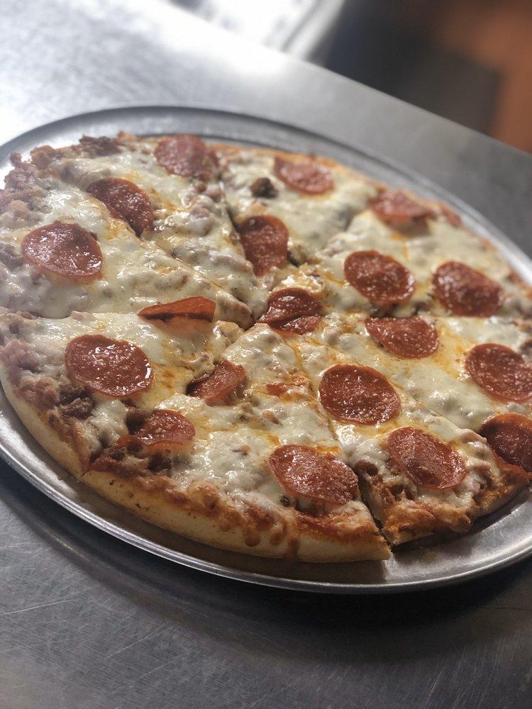 Gina's Pizza & Deli: 301 N Clinton St, Albion, MI