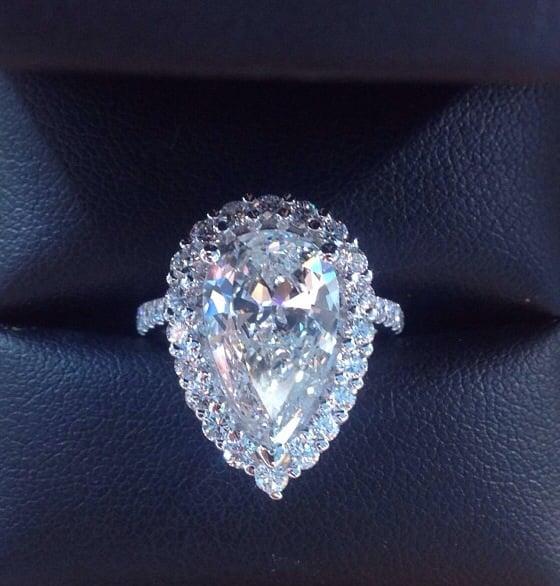 5 Carat Pear Shape Diamond Set In A Pave Halo Setting