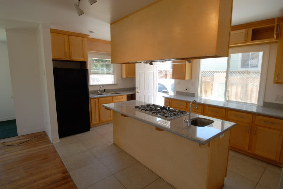 Kitchen remodel with cabinets suspended from ceiling over ...