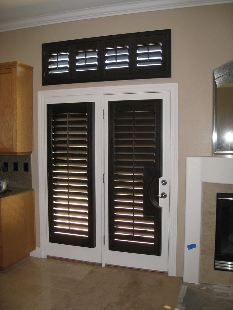 Beautiful black walnut stained wood shutters custom fit for Wood doors and shutters