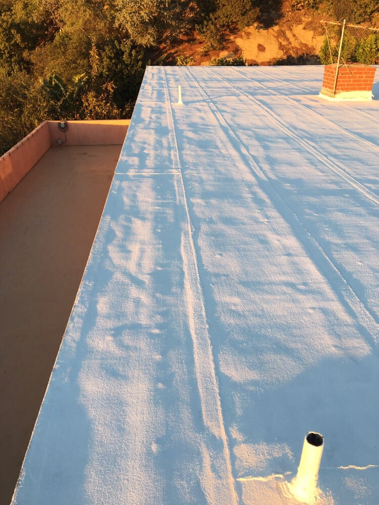 Torch Down And White Elastomeric On The Flat Roof In