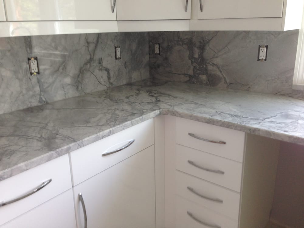 super white exotic kitchen granite countertops with full granite backsplash in troy mi yelp. Black Bedroom Furniture Sets. Home Design Ideas