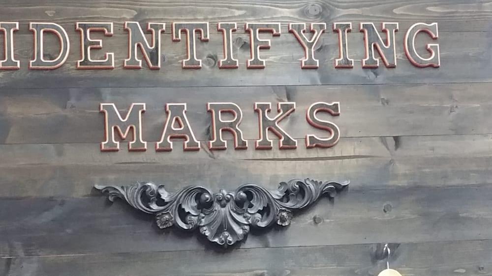 Identifying Marks: 214 W Alamo St, Brenham, TX