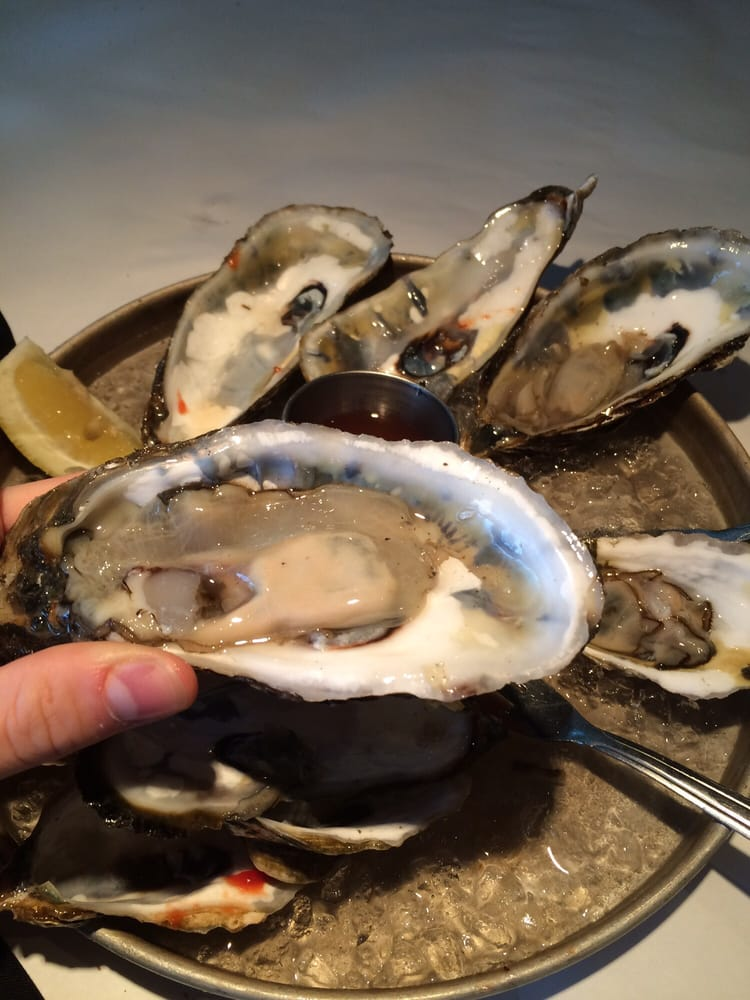 The size of my blue point oysters a couple east beach for Fish restaurant marlborough ma