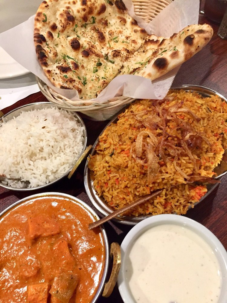 Photo of Everest Curry Kitchen - Sandy, UT, United States. Chicken Tikka Masala and a lamb rice dish