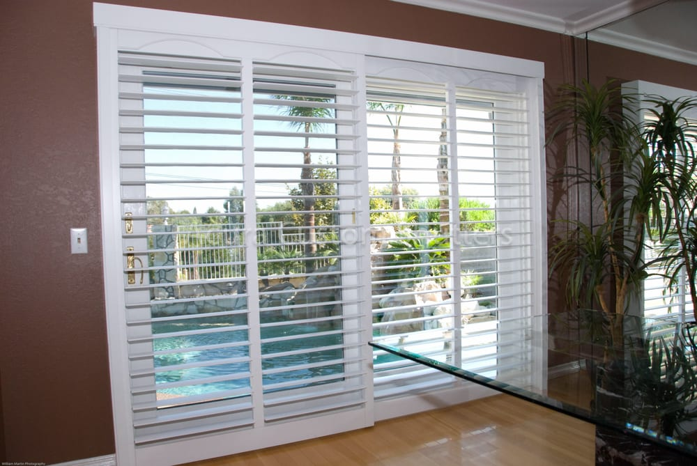 Bypass Shutter System Installed Over An 8 Sliding Glass