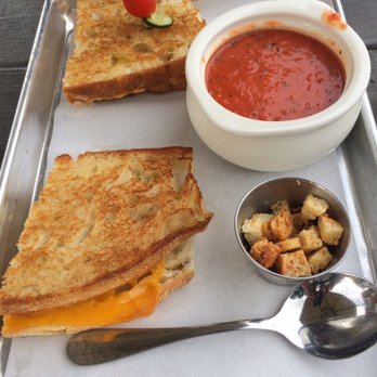 Rustic grilled cheese with tomato soup. Sandwich as expected, soup was ...