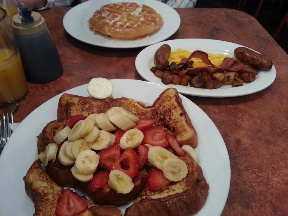 Challah french toast with strawberries and banana. Daddy o ...