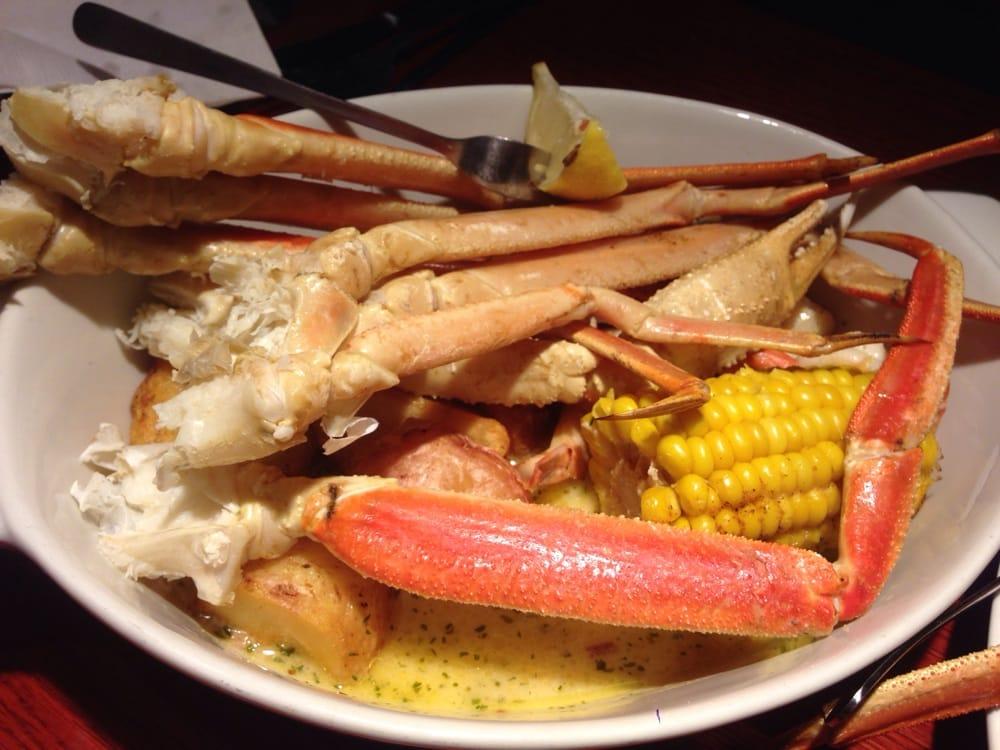 Seafood bake: crab legs, shrimp, scallops, potatoes and corn