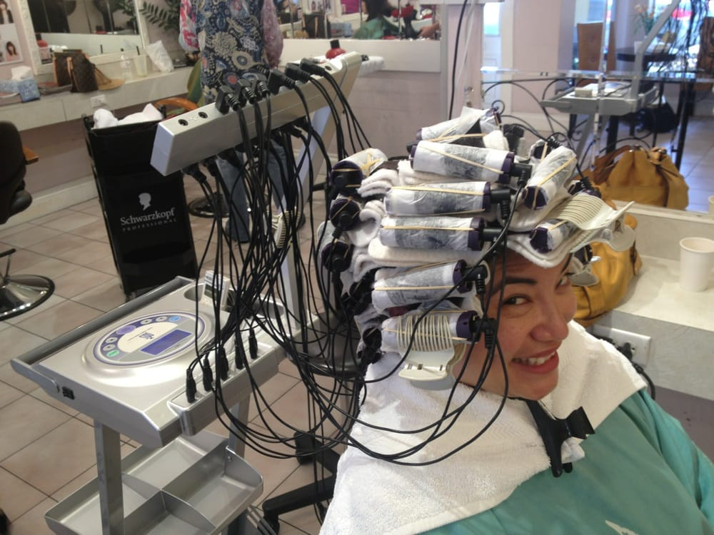 They put curlers in your hair and use this sci fi machine for 4 star salon services