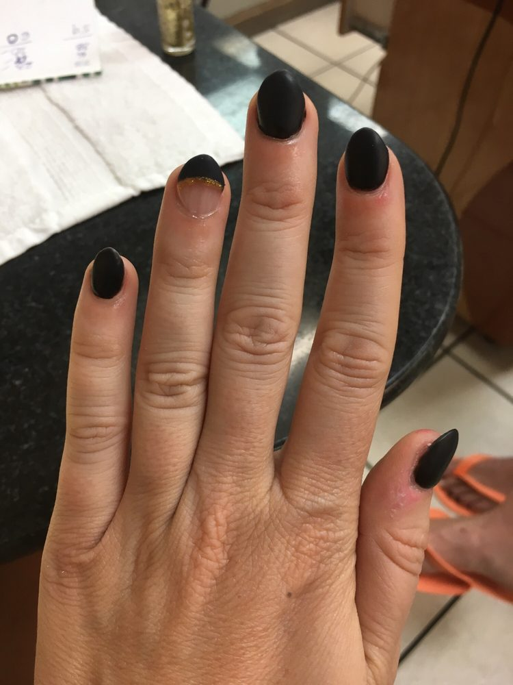 Matte black almond nail with gold design - Yelp